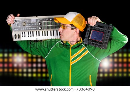 DJ Holding Equipment on Shoulders with Colorful lights in the background - stock photo