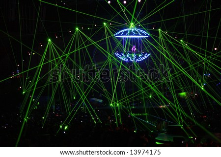 DJ in laser beams - stock photo
