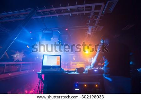 DJ in the night club - stock photo