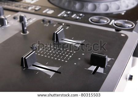 Dj mixer and cd player, closeup on white - stock photo