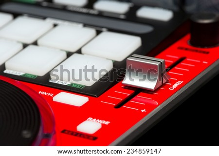 DJ mixer controller. Fader and buttons of cool red sound mixing console in nightclub. Selective focus. - stock photo
