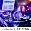 Dj mixer with headphones at a nightclub - stock photo