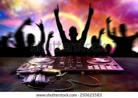 DJ mixes the track turntable to play music dance and crowd in nightclub at party  - stock photo