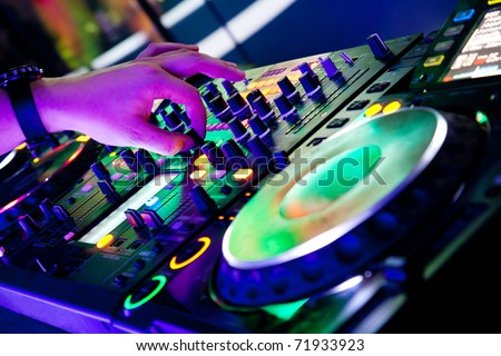 Dj mixes the track with one hand - stock photo