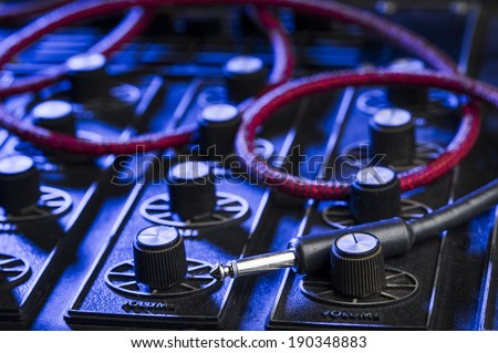 dj mixing board with an instrument cable. - stock photo