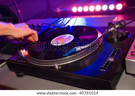 Dj mixing in night club - stock photo