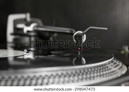 Dj needle stylus on vinyl record   - stock photo