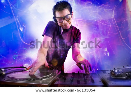 Dj playing disco house progressive electro music at the concert - stock photo