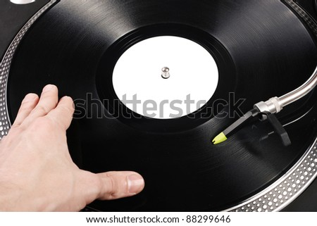 dj scratching the vinyl record - stock photo