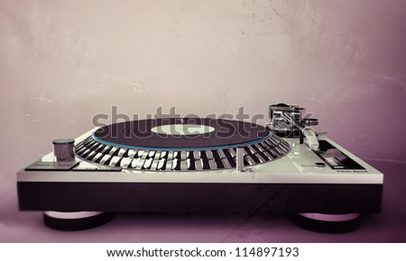 dj set isolated on pink background in old grunge photo - stock photo
