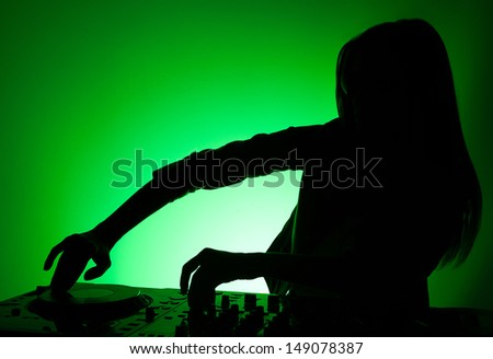DJ silhouette. Female DJ silhouette isolated on green - stock photo