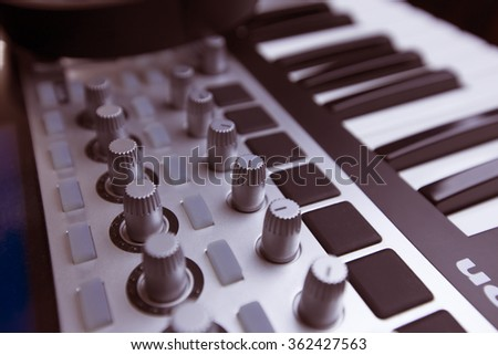 Dj sound equipment. Turning knobs, piano and headphones - stock photo