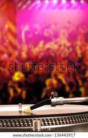 dj turntable with vinyl record in the dance club - stock photo