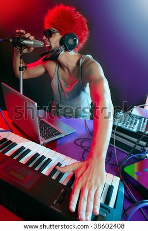 Dj with colorful light and music mixing digital equipment - stock photo