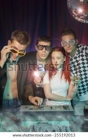 DJ with friends at a party having fun. - stock photo