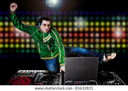 DJ with table and Club Lights in the background - stock photo