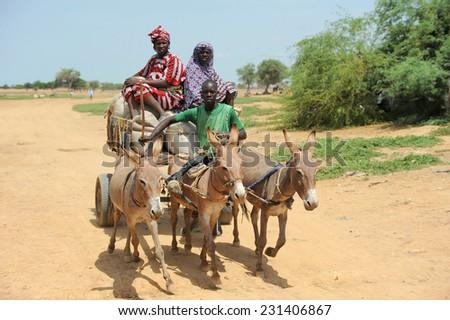 DJENNE, MALI, AFRICA - SEPTEMBER, 5, 2011 Family car, the way to market near Djenne - stock photo