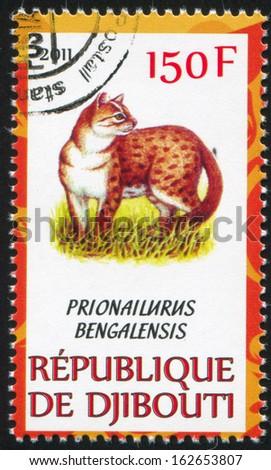 DJIBOUTI - CIRCA 2011: stamp printed by Djibouti, shows Leopard cat, circa 2011 - stock photo