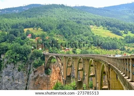 Djurdjevica Bridge over the Tara River in Montenegro - stock photo
