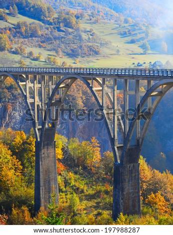 Djurdjevica Tara Bridge is a concrete arch bridge over the Tara River in northern Montenegro - stock photo