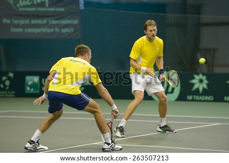 DNEPROPETROVSK, UKRAINE - APRIL 4, 2013: Robert Lindstedt (left) and Johan Brunstrom, Sweden on the training before Davis Cup match Ukraine vs Sweden. Ukraine won the match 3-2 - stock photo