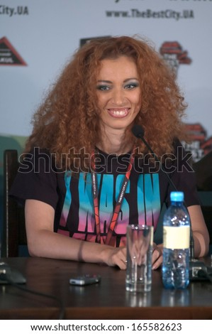 DNEPROPETROVSK, UKRAINE - JULY 13: Soloist of the Russian rock band LENINGRAD Julia Kogan during a press conference at the Festival THE BEST CITY.UA on July 13, 2013 in Dnepropetrovsk, Ukraine - stock photo