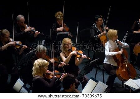 DNEPROPETROVSK, UKRAINE- JUNE 15:'Four seasons' Chamber Orchestra performed music of Elgar, Bruch, Tchaikovsky on June 15,2009 in Dnepropetrovsk, Ukraine - stock photo