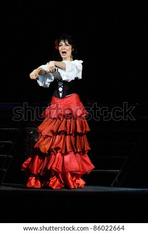 "DNEPROPETROVSK, UKRAINE - JUNE 3: Member of the Dnepropetrovsk State Opera and Ballet Theatre perform "" Carmen "" on June 3, 2011 in Dnepropetrovsk, Ukraine - stock photo"