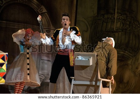 "DNEPROPETROVSK, UKRAINE - JUNE 25: Members of the Dnepropetrovsk State Opera and Ballet Theatre perform ""The Barber of Seville"" on June 25, 2011 in Dnepropetrovsk, Ukraine - stock photo"