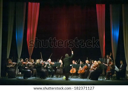 DNEPROPETROVSK, UKRAINE - MARCH 17: FOUR SEASONS Chamber Orchestra - main conductor Sergey Burko perform at the State Russian Drama Theatre on March 17, 2014 in Dnepropetrovsk, Ukraine - stock photo
