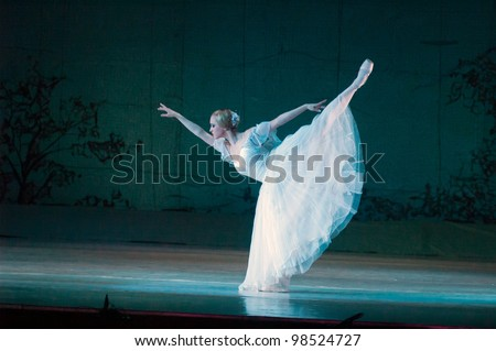 "DNEPROPETROVSK, UKRAINE - MARCH 25: Members of the Dnepropetrovsk State Opera and Ballet Theatre perform ""Giselle"" on March 25, 2012 in Dnepropetrovsk, Ukraine - stock photo"