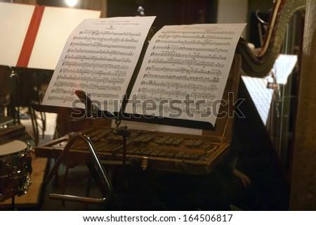 DNEPROPETROVSK, UKRAINE - NOVEMBER 25: Sheet music by Gustav Mahler during the performance of the Academic Symphonic Orchestra on November 25, 2013 in Dnepropetrovsk, Ukraine - stock photo