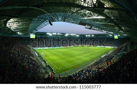 DNEPROPETROVSK, UKRAINE - OCTOBER 7: Dnipro Stadium Arena during Ukrainian Championship match FC Dnepr vs. FC Dynamo on October 7, 2012 in Dnepropetrovsk, Ukraine - stock photo