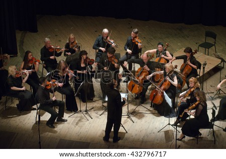 DNIPRO, UKRAINE - JUNE 6, 2016: FOUR SEASONS Chamber Orchestra - main conductor Dmitry Logvin perform at the State Russian Drama Theatre - stock photo
