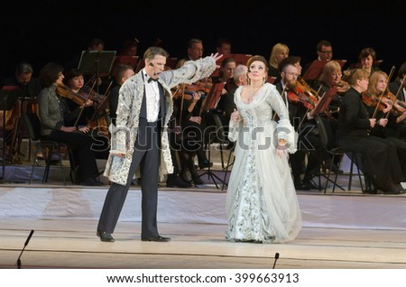 DNIPROPETROVSK, UKRAINE - APRIL 1, 2016: Members of the Dnepropetrovsk State Opera and Ballet Theatre perform One lives on two stages. - stock photo
