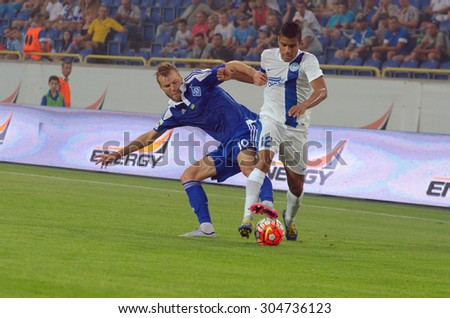 DNIPROPETROVSK, UKRAINE - AUGUST 9, 2015: Leo Matos FC Dnipro (R) fights for the ball with Andriy Yarmolenko FC Dynamo(L) during Ukrainian Championship game. - stock photo