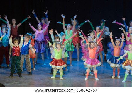 DNIPROPETROVSK, UKRAINE - DECEMBER 24, 2015: Unidentified children, ages 4-11 years old, perform Madame Bobo at the State Palace of children and youth. - stock photo