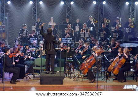 DNIPROPETROVSK, UKRAINE - DECEMBER 4, 2015: Youth Symphony Orchestra FESTIVAL - main conductor Dmitry Logvin perform at the concert hall. - stock photo