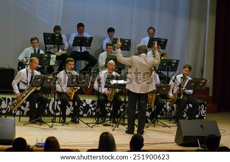 DNIPROPETROVSK, UKRAINE - FEBRUARY 10: Members of the Philharmonic Society Jazz Orchestra perform on February 10, 2015 in Dnipropetrovsk, Ukraine - stock photo