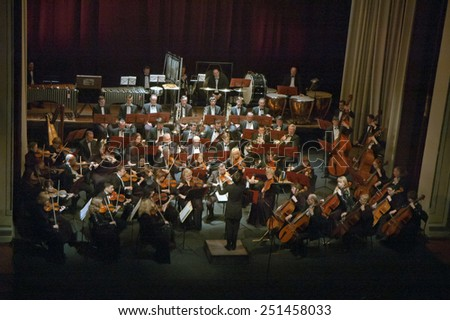 DNIPROPETROVSK, UKRAINE - FEBRUARY 9: Members of the Symphonic Orchestra - main conductor Natalia Ponomarchuk perform at the State Russian Drama Theatre on Feb. 9, 2015 in Dnipropetrovsk, Ukraine - stock photo