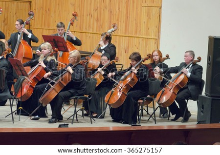 DNIPROPETROVSK, UKRAINE - JANUARY 16, 2016: Members of the Symphonic Orchestra perform at the Conservatory. - stock photo