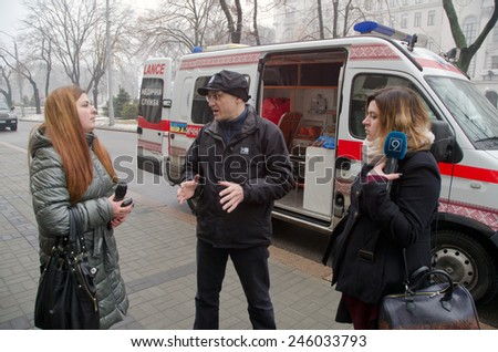 DNIPROPETROVSK, UKRAINE - JANUARY 20, 2015 : Volunteer Pavlo Khazan presents an ambulance acquired to assist the Ukrainian military in the zone of the antiterrorist operation. - stock photo