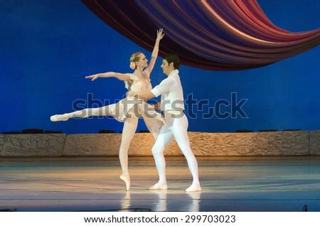 DNIPROPETROVSK, UKRAINE - JUNE 27, 2015:  Dancers Elena Pechenyuk and Dmitry Omelchenko perform BALANCHINE at State Opera and Ballet Theatre. - stock photo