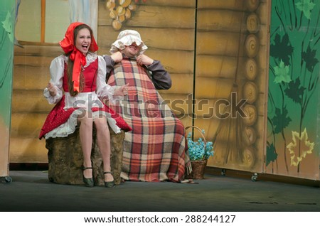 DNIPROPETROVSK, UKRAINE - JUNE 14, 2015: Members of the Dnipropetrovsk State Russian Drama Theatre perform Curious Little Red Riding Hood. - stock photo