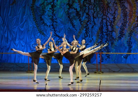 DNIPROPETROVSK, UKRAINE - JUNE 27, 2015: Unidentified girls, ages 12-14 years old, perform People stage dance at State Opera and Ballet Theatre.  - stock photo