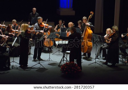 DNIPROPETROVSK, UKRAINE - MAY 26: FOUR SEASONS Chamber Orchestra - main conductor Sergey Burko perform at the State Russian Drama Theatre on May 26, 2015 in Dnipropetrovsk, Ukraine - stock photo