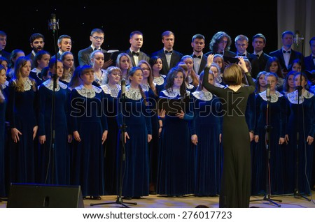 DNIPROPETROVSK, UKRAINE - MAY 6: Members  of the Conservatory Choir perform at the Philharmonic on May 6, 2015 in Dnipropetrovsk, Ukraine - stock photo