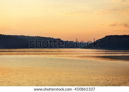 Dnister river, Ukraine. Landscape of river Dniestr. Beautiful landscape with magnificent cloudy sky in sunset. - stock photo