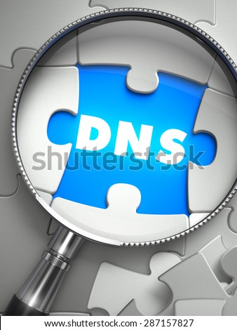 DNS - Domain Name System - Puzzle with Missing Piece through Loupe. 3d Illustration with Selective Focus.  - stock photo