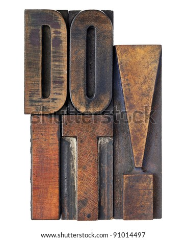 do it exclamation - motivation concept - isolated text in vintage wood letterpress printing blocks stained by color inks - stock photo